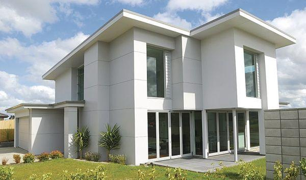 Ilustrační foto (www.shutterstock.com), dům obložený deskami Megapan