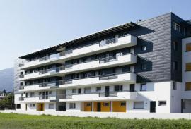 Bytový komplex v Brixenu, opláštění fasádním šindelem