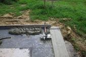 Hydroizolace a příprava na pokládku první vrstvy zdiva