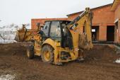 Terénní úpravy po dokončení hrubé stavby domu - využijeme strženou ornici
