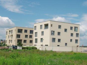 Omítnuté novostavby bytových domů
