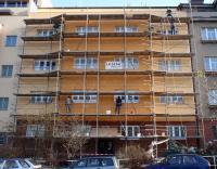 Zateplená obálka bytového domu + nová fasáda