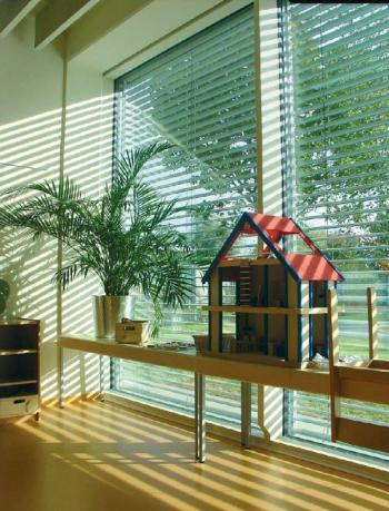 Velké skleněné okenní plochy pasivního domu