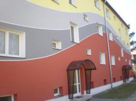 Zatplený bytový dům