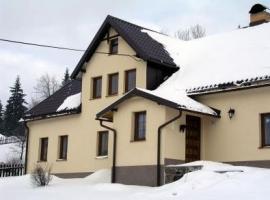 Dům se střechou Lindab v zimě