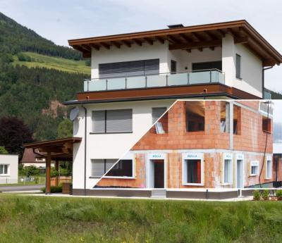 Dům vhrubé stavbě a po zateplení a omítnutí